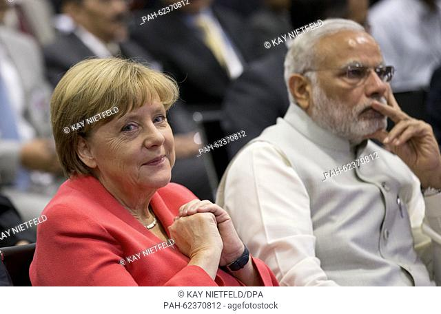 German Chancellor Angela Merkel and Indian Prime Minister Narendra Modi (R) visit the Robert Bosch GmbH in Bangalore, India, 06 October 2015