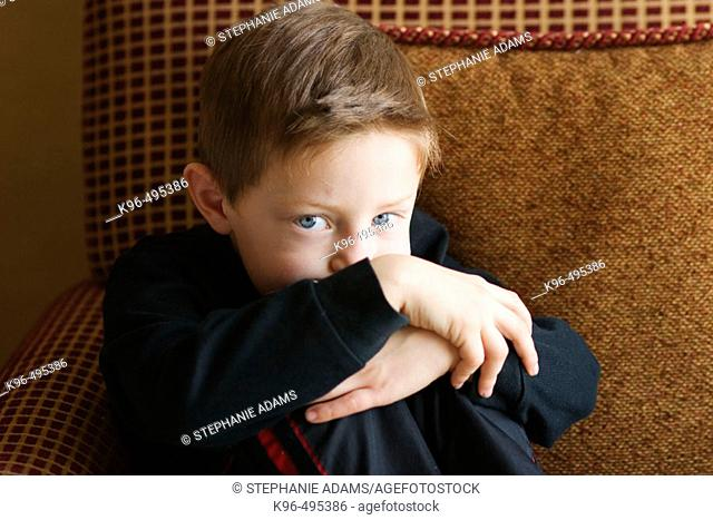 young boy on cushion chair