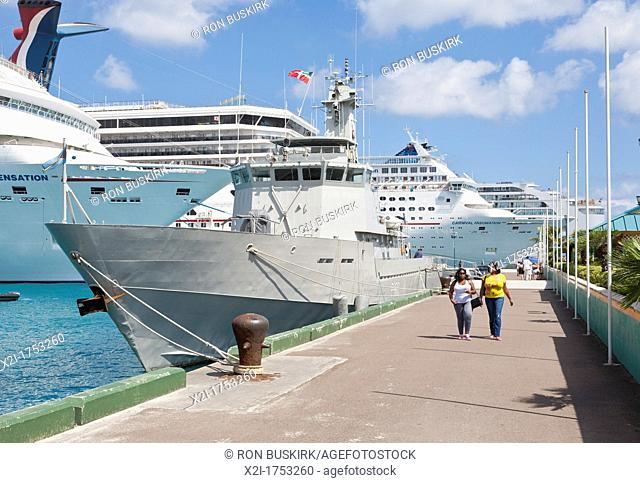 Two black cruise ship passengers leaving docks to explore the town of Nassau, Bahamas