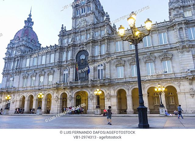 City hall at dusk, Plaza de Maria Pita square, Coruña city, Galicia, Spain