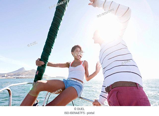 Young couple on yacht, laughing