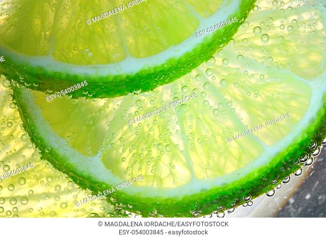 Lemon Slices In Water With Air Bubbles