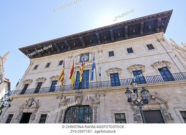 City hall in Plaza Cort with balcony and flags in Palma de Mallorca, Balearic islands, Spain