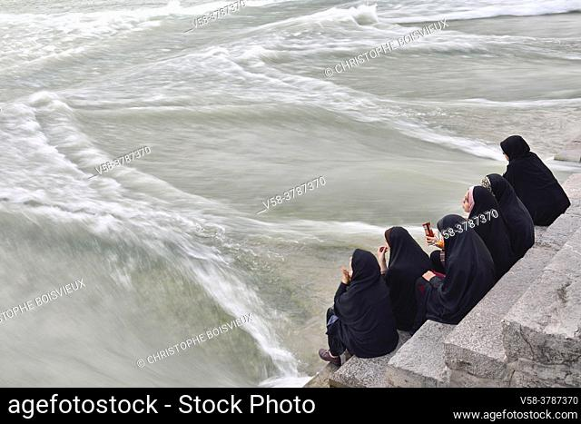 Iran, Isfahan, World Heritage Site, Khaju bridge, Women watching Zayandeh river