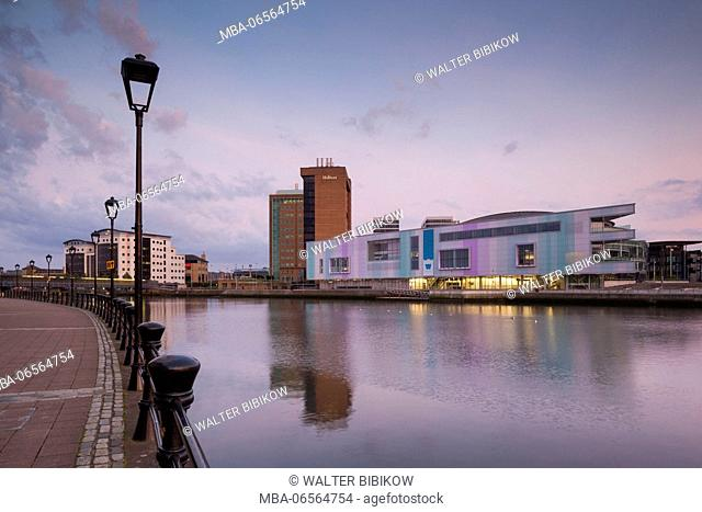 UK, Northern Ireland, Belfast, city skyline along River Lagan with Waterfront Hall, dusk