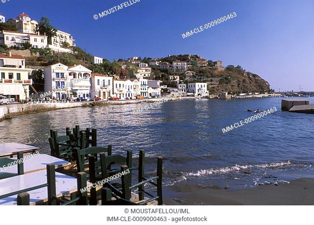 View of the port in Evdilos, houses, sea, small beach Ikaria, Northeastern Aegean Island, Greece