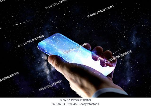 close up of hand with glass smartphone over space