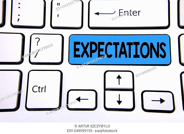 Writing note showing Expectations. Business photo showcasing Huge sales in equity market assumptions by an expert analyst written Blue Key Button White Keyboard...