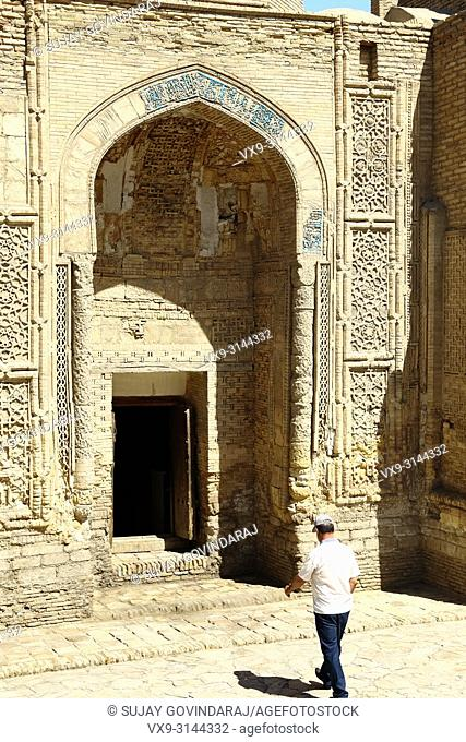 Bukhara, Uzbekistan - August 27, 2016: Unknown man entering Magoki Attori, a 16th century mosque that was built on the site of the pre-Islamic Moh temple in...