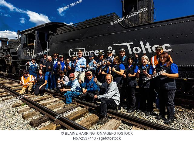 Governor John Hickenlooper (of Colorado) poses with two train crews at the meeting point at Osier, Colorado on a visit to the the Cumbres & Toltec Scenic...