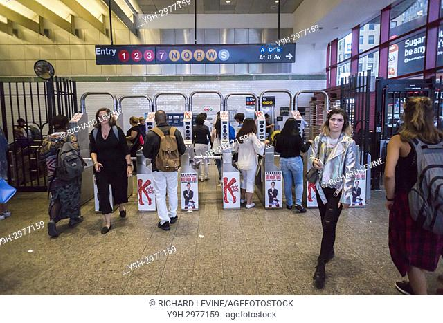 Commuters and passer-by at the Times Square subway station in New York on Thursday, July 27, 2017. NYS Governor Andrew Cuomo has called on the private sector to...