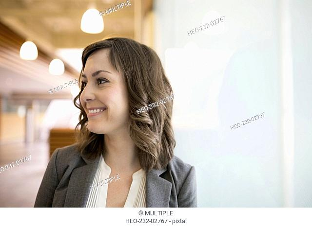 Portrait smiling brunette businesswoman looking away