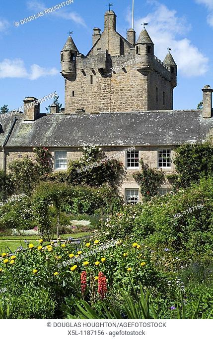 Cawdor Castle CAWDOR INVERNESSSHIRE Gardens flowers path cottage and castle tower