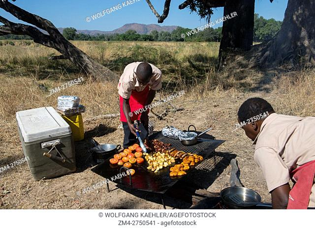 Chefs cooking a bush breakfast in South Luangwa National Park in eastern Zambia