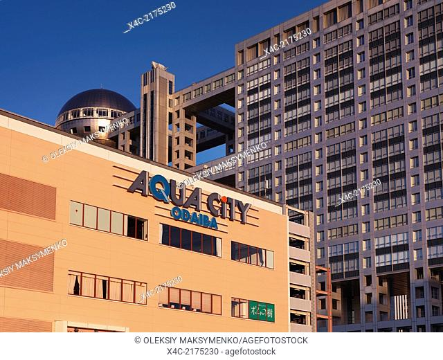 Aqua city sign and Fuji TV building in the background, tourist attractions in Odaiba, Tokyo, Japan