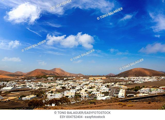 Lanzarote Yaiza white houses village under volcanic mountains of Canary Islands