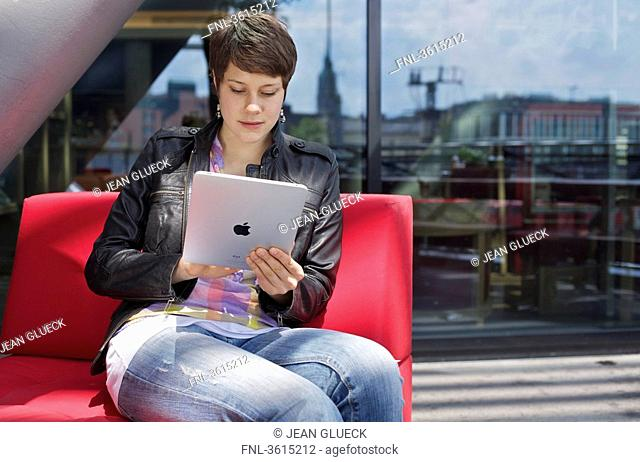 Young woman using iPad
