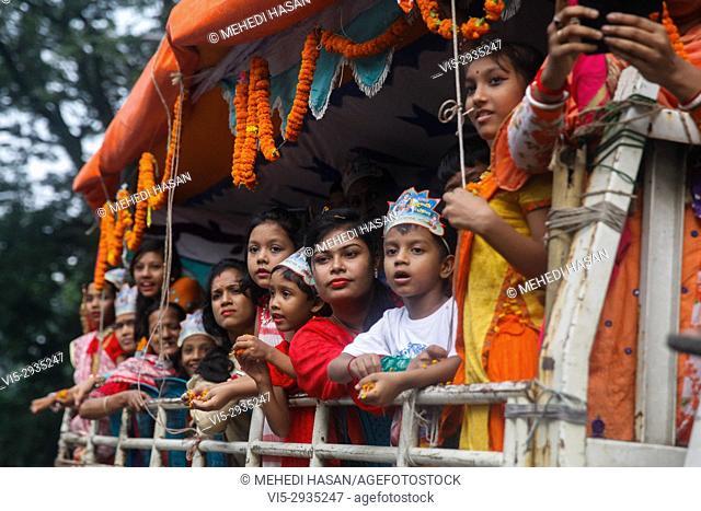 Bangladeshi Hindu devotees take part in a procession during the celebration of Janmashtami or Lord Krishna's Birthday at Dhaka, Bangladesh