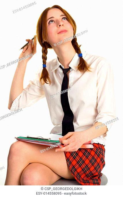 Beautiful lady writing on a worksheet