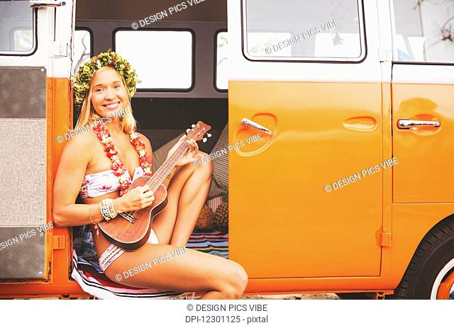 Beach Lifestyle, Beautiful Surfer Girl With Ukulele And Classic Vintage Surf Van On The Beach At Sunset