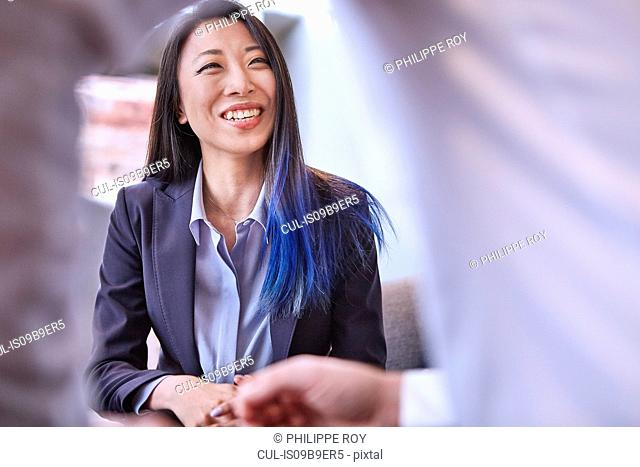Woman looking at colleague smiling