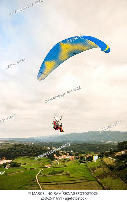 Paraglider flying over the beach Toranda. Niembro, LLanes, Asturias, Spain