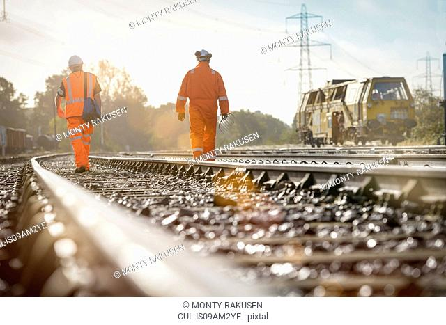 Maintenance workers on railway, rear view