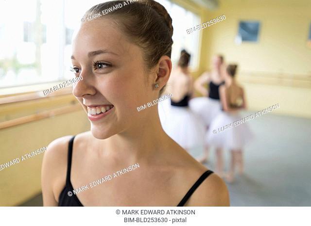 Portrait of smiling girl in ballet studio