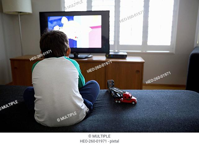 Boy watching TV in living room