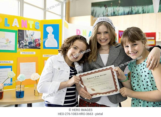 School girls with award at science fair