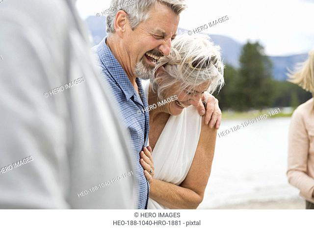 Cheerful couple laughing outdoors