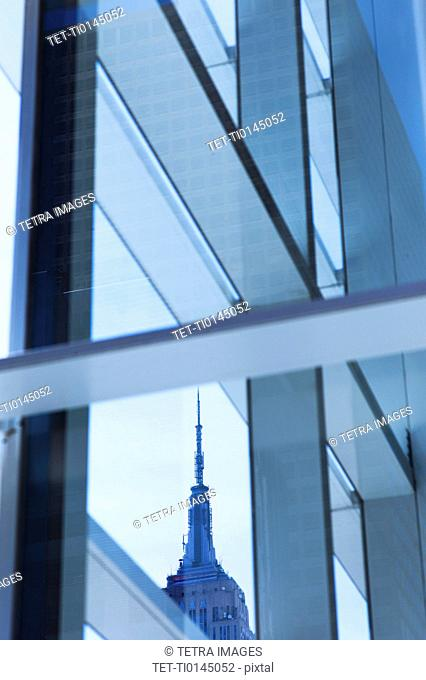 USA, New York, New York City, Empire State Building seen behind window frame