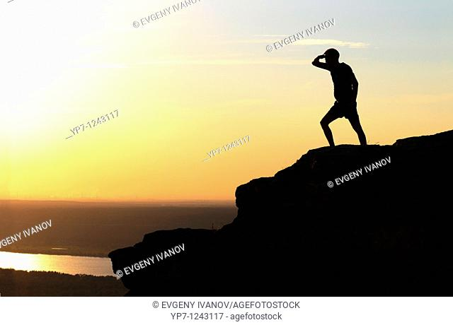 Man observes Volga river from the highest point of Zhiguli mountains in Russian National Park 'Samara Luka'