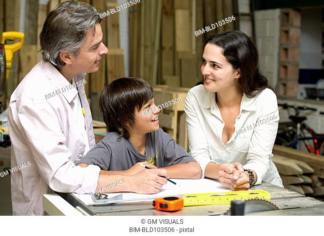 Hispanic family in carpentry workshop