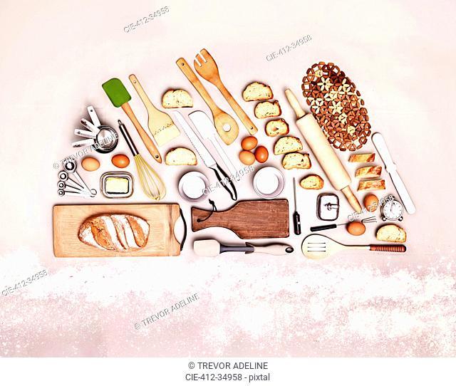 Still life concept baking utensils forming bread loaf
