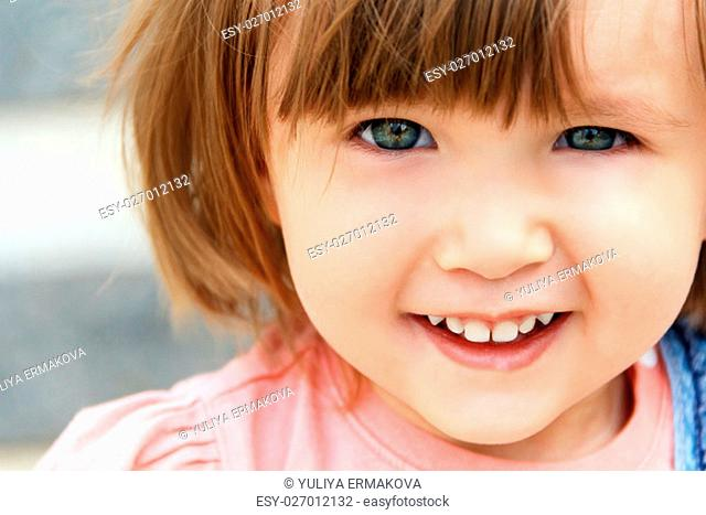 Photo of cute smiling Caucasian girl with short hair