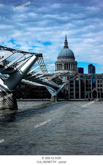 Millennium Bridge over River Thames, St Paul's Cathedral in background, London, England, UK
