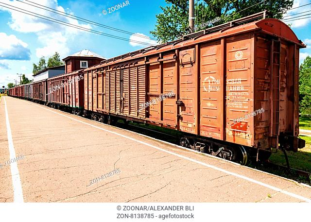 BOROVICHI, RUSSIA - JULY 18, 2015: The cars of a freight train standing at a provincial railway station