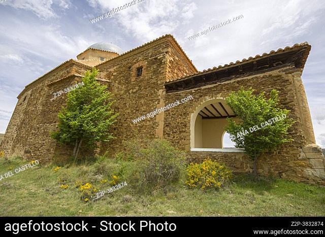 Villarroya de los Pinares Teruel Spain Medieval architecture in the stone village. San Benon hermitage on hill