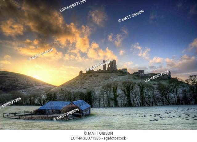 England, Dorset, Corfe Castle. Winter sunrise over Corfe Castle