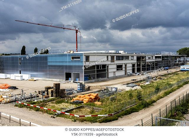 Rotterdam, Netherlands. An Enterprise new Building being cosntructed on the grounds of an Industrial Estate