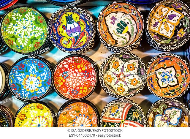 Collection of Traditional Turkish ceramics on sale at Grand Bazaar in Istanbul, Turkey. Colorful ceramic souvenirs