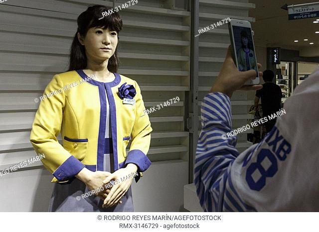 September 26, 2018, Tokyo, Japan - A visitor takes a picture of humanoid robot Junko Chihira working at an information center at Aqua City Odaiba