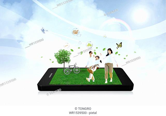 a family walking in a park on a smart phone