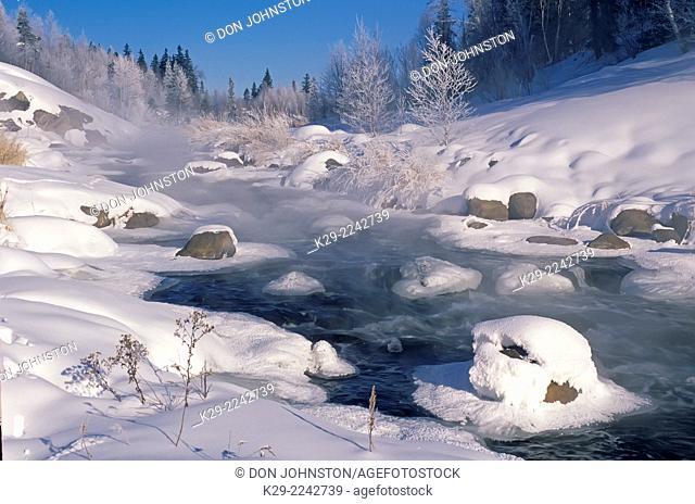 Junction Creek witn open water in mid winter, Greater Sudbury, Ontario, Canada