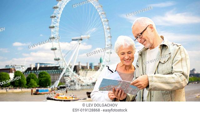 family, age, tourism, travel and people concept - senior couple with map over london ferry wheel background