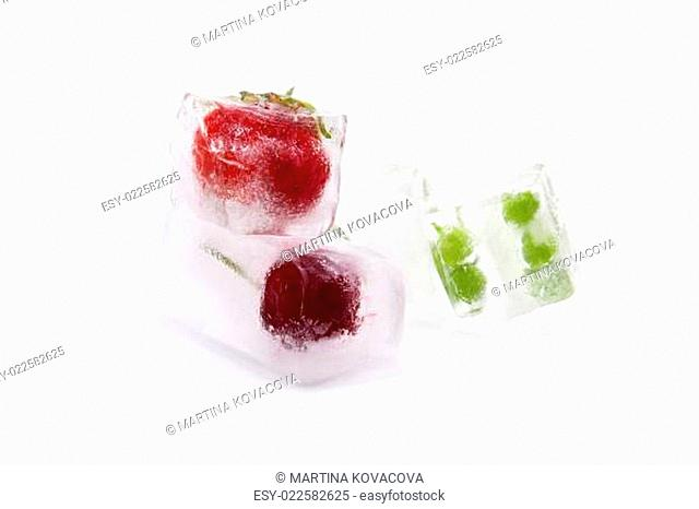 Fruit and vegetable frozen in ice