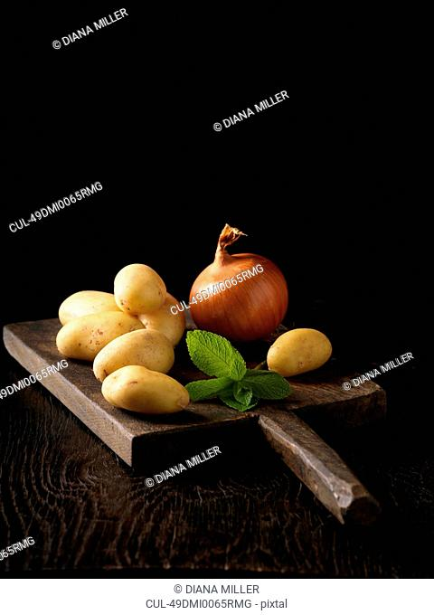 Board of potatoes and onions