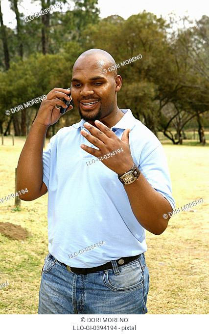 Man speaking on cell phone, Johannesburg, South Africa