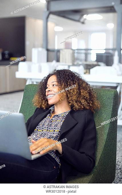 Smiling architect using laptop